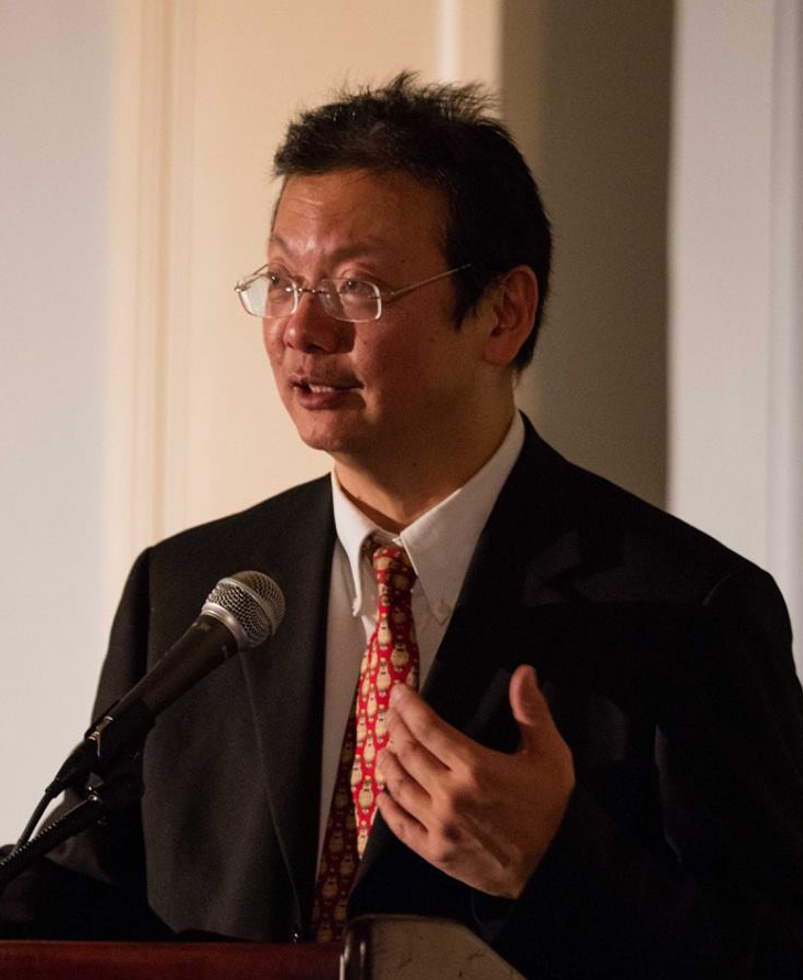 Andy Chiang speaking at a podium
