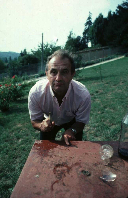 Chef Paul Bocuse, playing mumbly peg in his garden in Lyon, 1983.