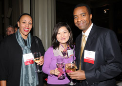 From left: Club of North Florida President Paki Taylor SM '01; Ying Cao '01, MNG '02; and Martin Mbaya '00, who received the Harold E. Lobdell '17 Distinguished Service Award for his alumni relations volunteer work. Photo: Darren McCollester.