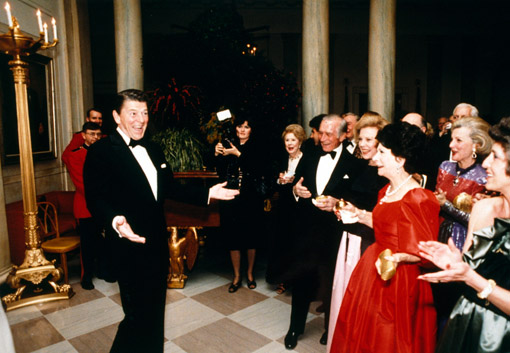 Ronald Reagan looks dashing to of a group of admiring women, just before blowing out his 70 birthday candles in 1981. His birthday was February 6 (© Owen Franken/Sygma/Corbis).