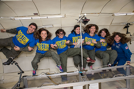 Emily Calandrelli (second from left) and Astronaut Cady Coleman '83 experience weightlessness in the VOMIT Comet with a team of MIT researchers on an episode of Xploration. Photo: Calandrelli