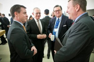 Israel Ruiz, MIT executive vice president and treasurer, left; MIT President L. Rafael Reif; Bob Reynolds, CEO of Putnum Investments; and Scott Blackmun, CEO of the United States Olympic Committee