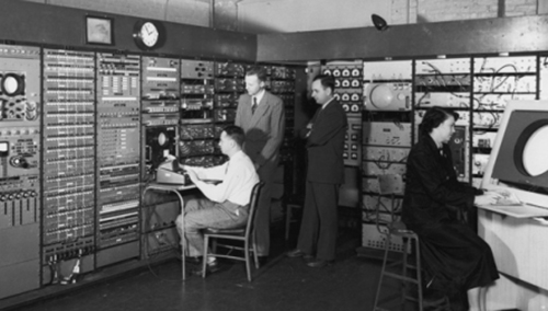Forrester (second from left) stands in the operations center for Whirlwind I, the early computer project he oversaw at MIT.