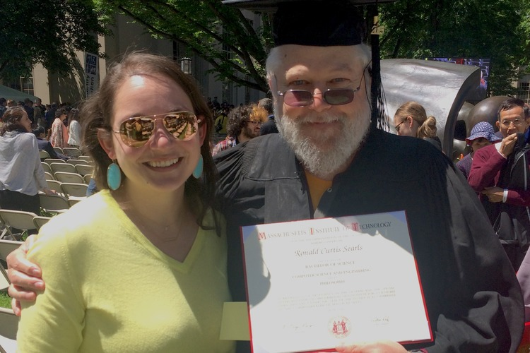 Man graduating from MIT with his daugher