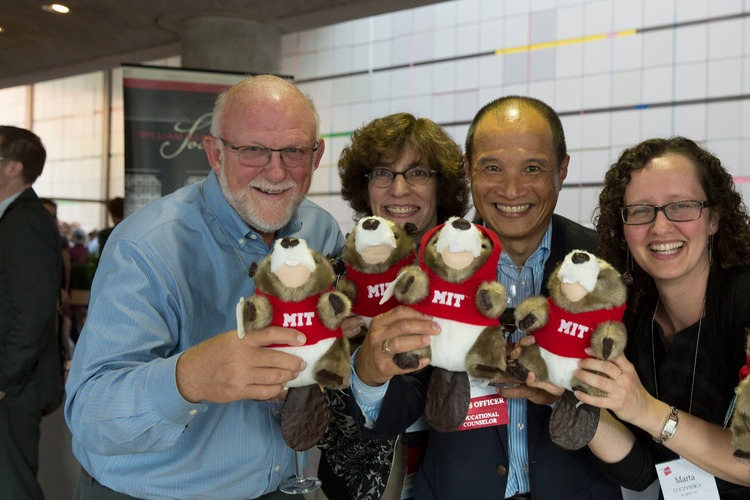 "MIT alumni holding stuff animal mascots ""Tim the Beaver"""