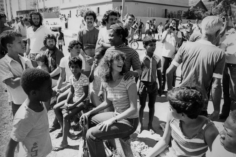 Janice Perlman (seated at center), in 1973, with residents of Rio de Janeiro's Conjunto de Quitungo Housing Project.