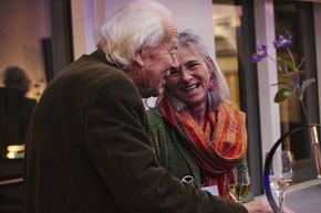 Elderly couple smiling and talking