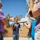 An MIT student speaks to a group on campus