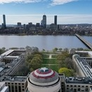 View of the Boston skyline with Captain America's shield on the MIT Great Dome