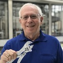 Robert G. Gottlieb '60, SM '61 with the adjustable wrench he invented.
