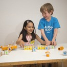 Kids play with the Kinderlabs KIBO robot