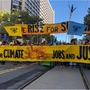 "Protest banners: ""Rise for Climate, Jobs, and Justice"""